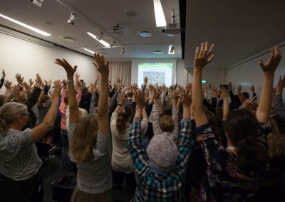 People raising their hand at a session, Pain in Europe X